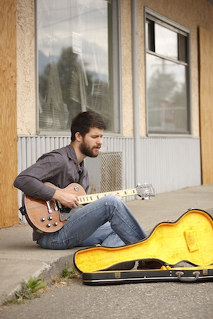 andrew-playing-guitar-in-front-of-old-ice-cream-shop